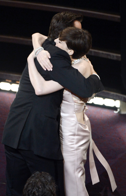 Anne Hathaway and Hugh Jackman hugged.