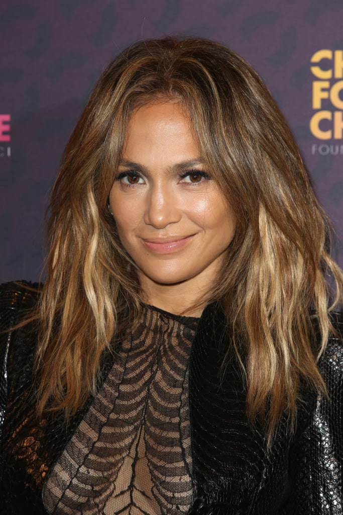 As usual, Jennifer Lopez was glowing at the Chime For Change event with her ombré hair color setting off her bronzed complexion.