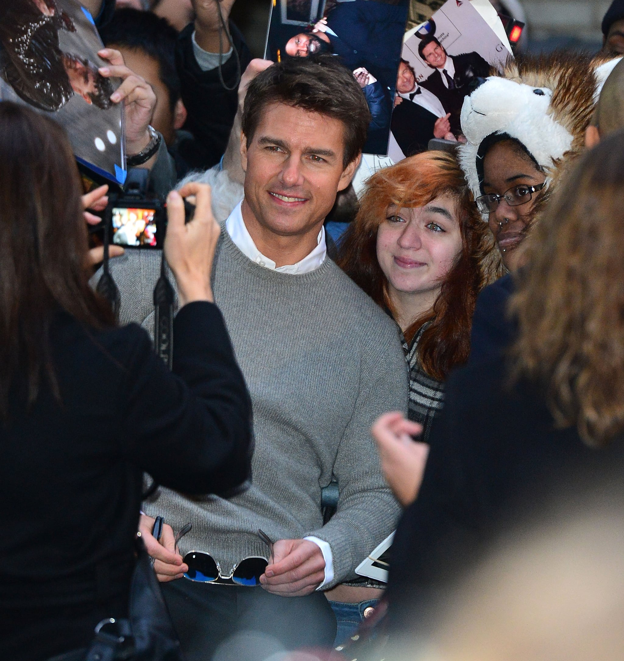 Tom Cruise posed with fans.