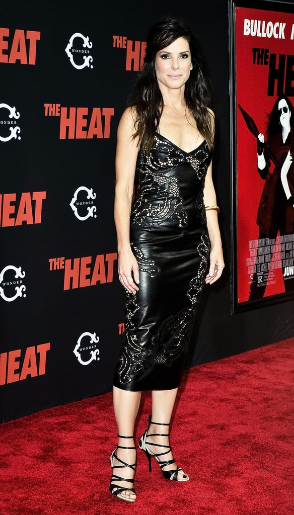Sandra showed off her sexiest look yet at the NYC premiere in a laser-cut leather sheath and strappy leather sandals — with coordinating black polish on her toes.