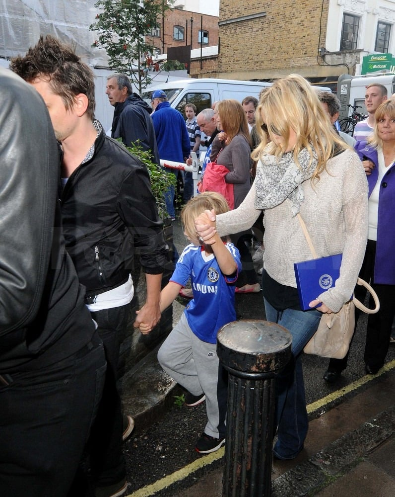 Matt and Kate kept a tight grip on Ryder's hand leaving the stadium.