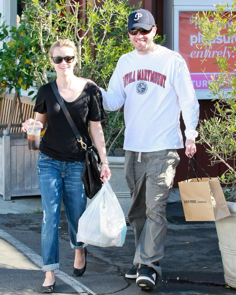 Jim Toth and Reese Witherspoon were all smiles in Dec. 2010.