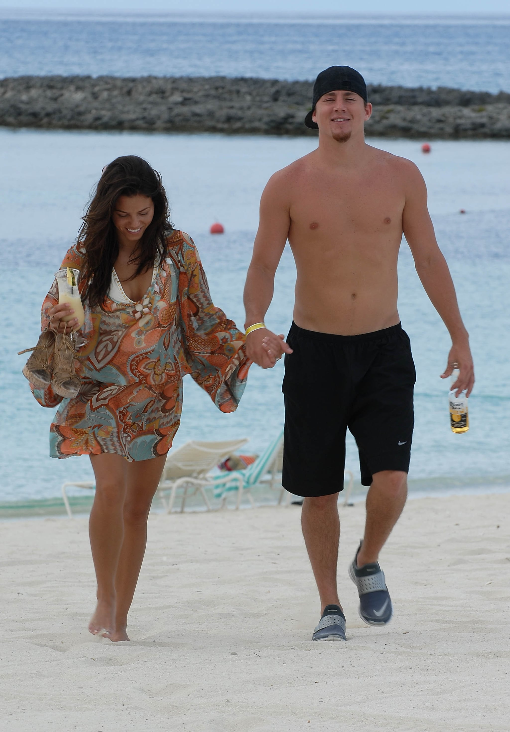 Channing went shirtless to hit the beach with Jenna in July 2007.