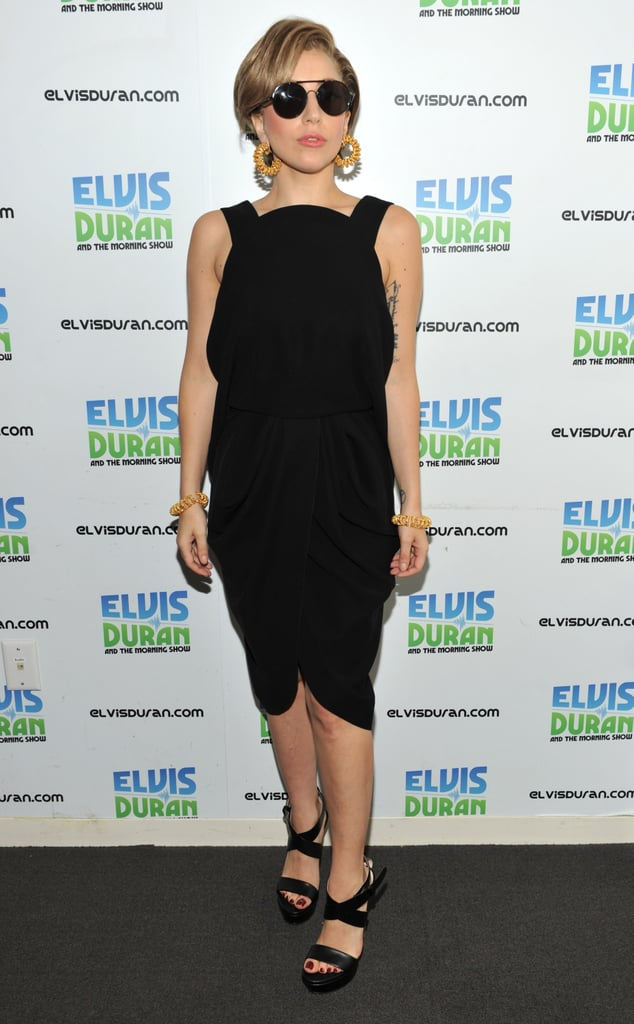 Lady Gaga visited the Z100 studio in a black Balenciaga by Alexander Wang ensemble that she accented with gold hoops.