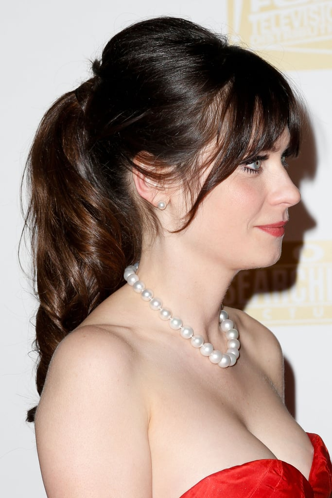 Zooey Deschanel posed for cameras at the Fox Golden Globe after party.