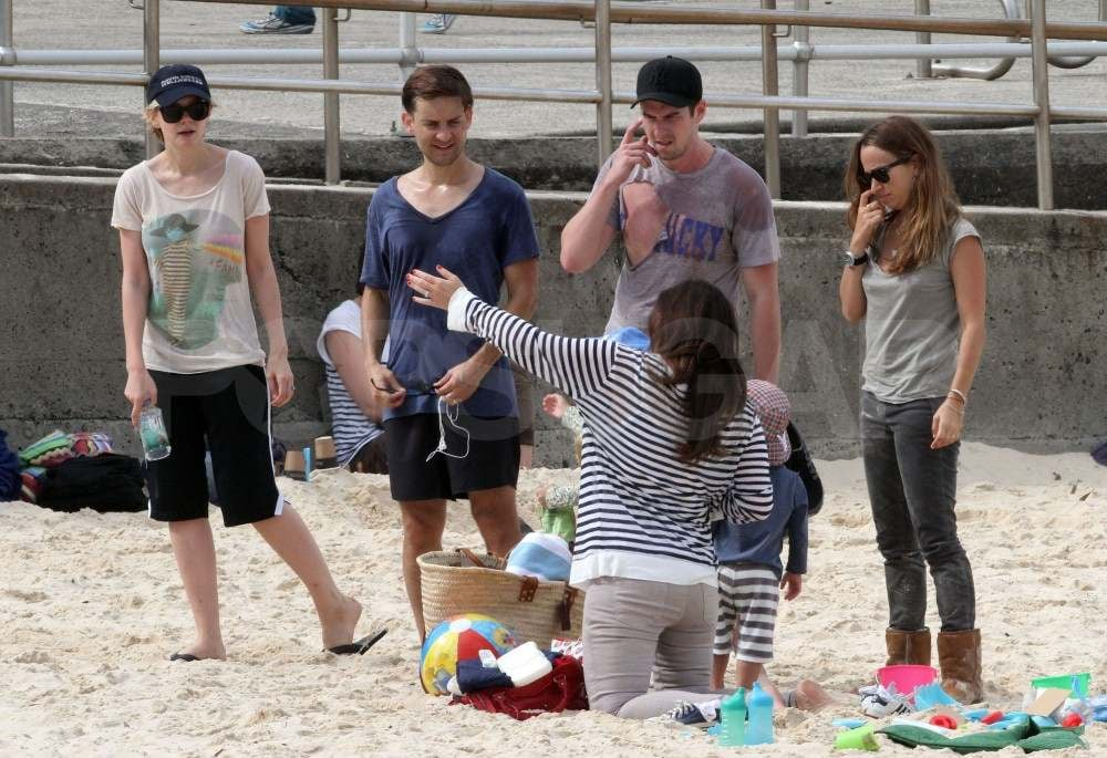 Jennifer Meyer and Tobey Maguire with Carey Mulligan on the beach.