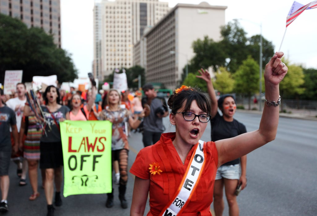 Pro-choice protesters marched along Austin's Congress Avenue holding up signs and American flags.