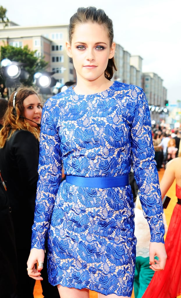 Kristen accessorized her blue lace dress with a matching satin belt.