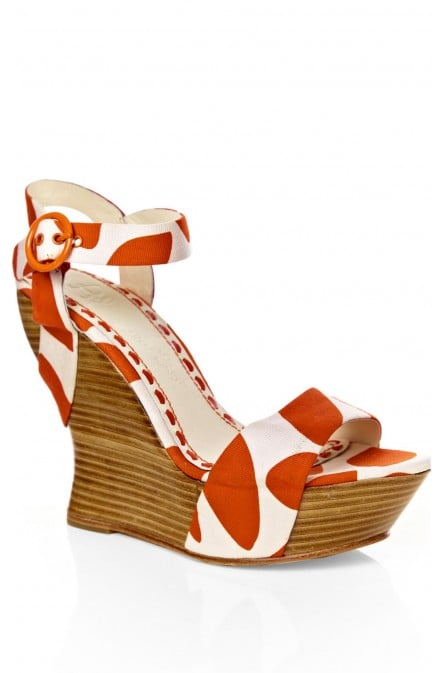These wedges maintain a classic feel, thanks to a wood-heel — but also boast a fresh print.  Alice + Olivia Joyce Printed Canvas Wedge ($265)
