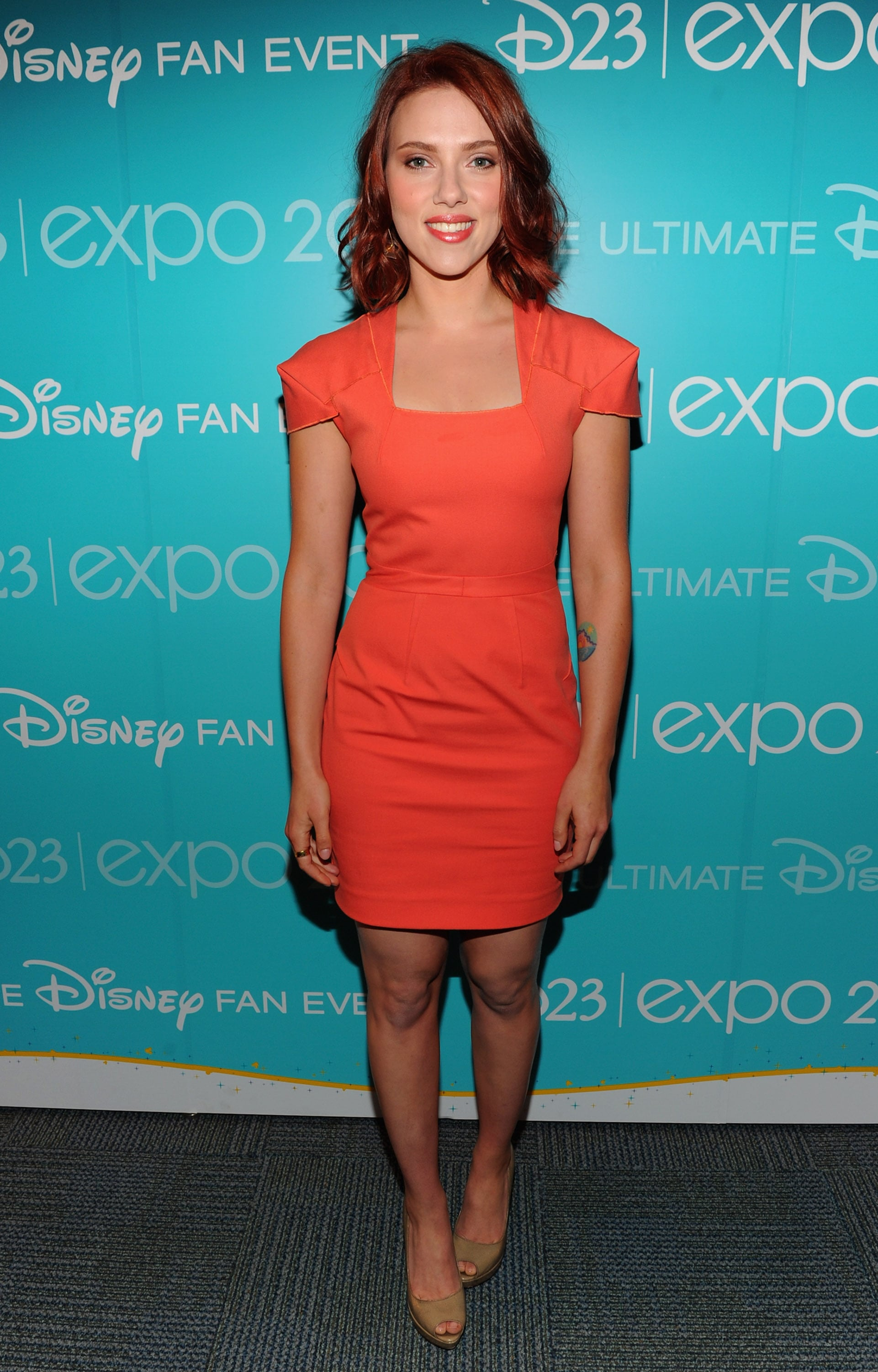 Scarlett Johansson lit up the room in a coral minidress.