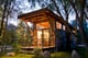 """Aptly named """"The Wedge,"""" this chic cabin features large windows to create the appearance of open space. Wheelhaus also builds all its tiny homes on wheels, allowing buyers the option of mobility with their small dwellings. Because of this fun feature, The Wedge's large windows can take in views of relaxing beaches and lush forests, not limited to one or the other."""