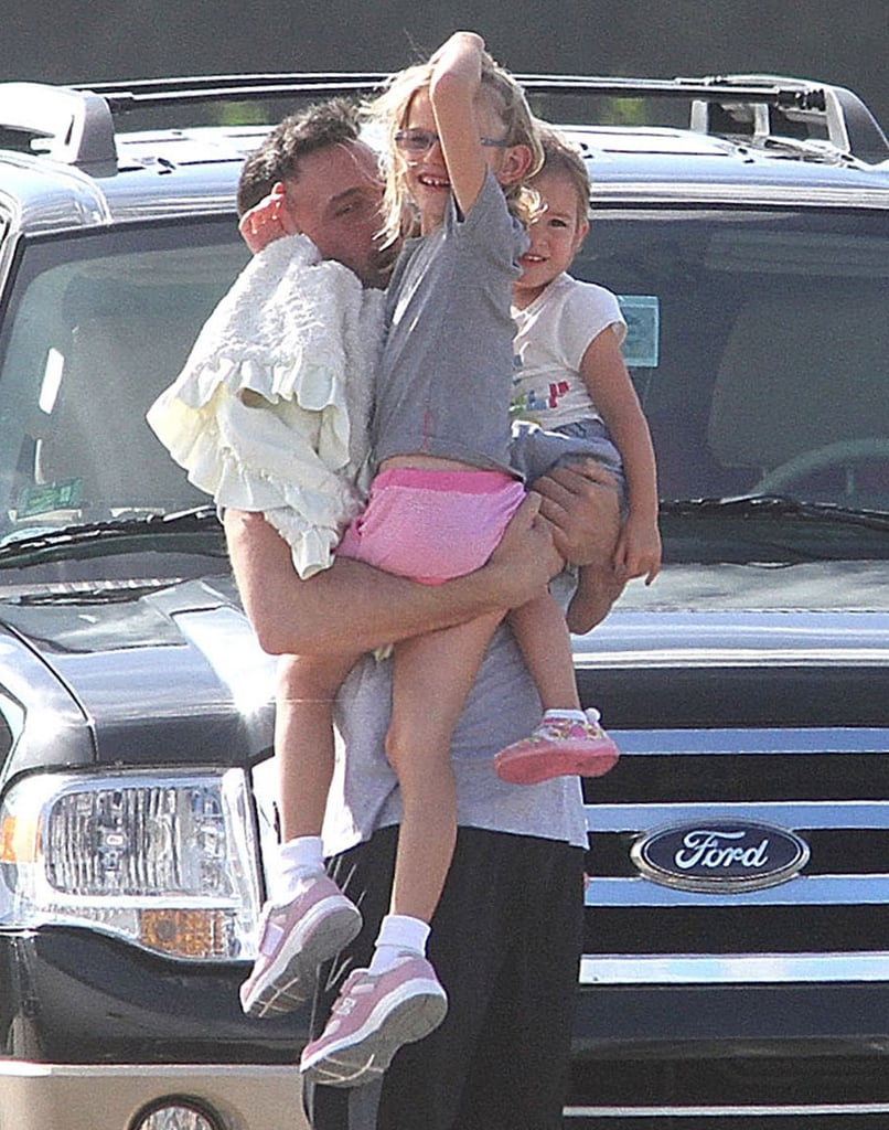 Ben Affleck gave his girls Seraphina Affleck and Violet Affleck a big hug after they touched down in Puerto Rico to visit him on the Runner, Runner set in July.