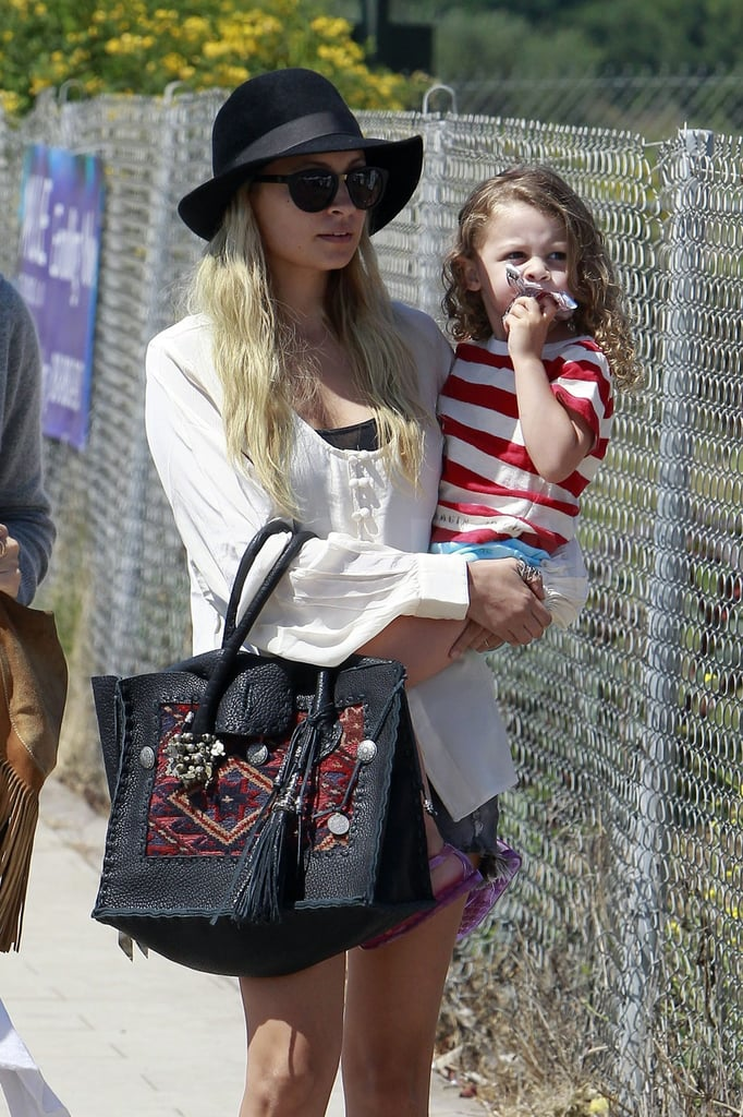 Nicole wore a bohemian bag for her casual day in Malibu.