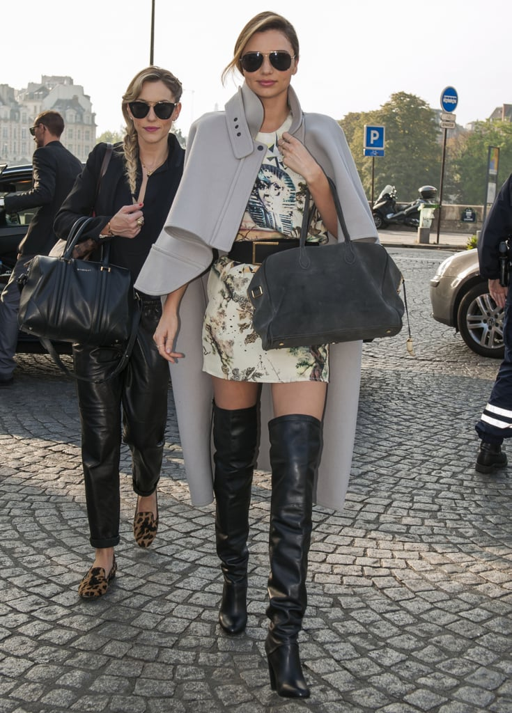 Between her catwalk turns and her street style appearances, Miranda Kerr has been busy in Paris! Our absolute favorite look was this polished combo of a minidress, thigh-high boots, and Chloé cape.