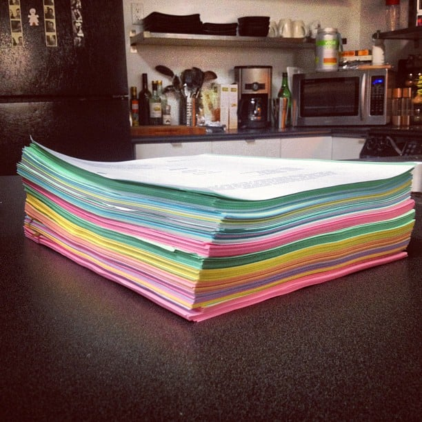 Patrick Adams shared a photo of his pile of 10 Suits scripts. Source: Instagram user halfadams