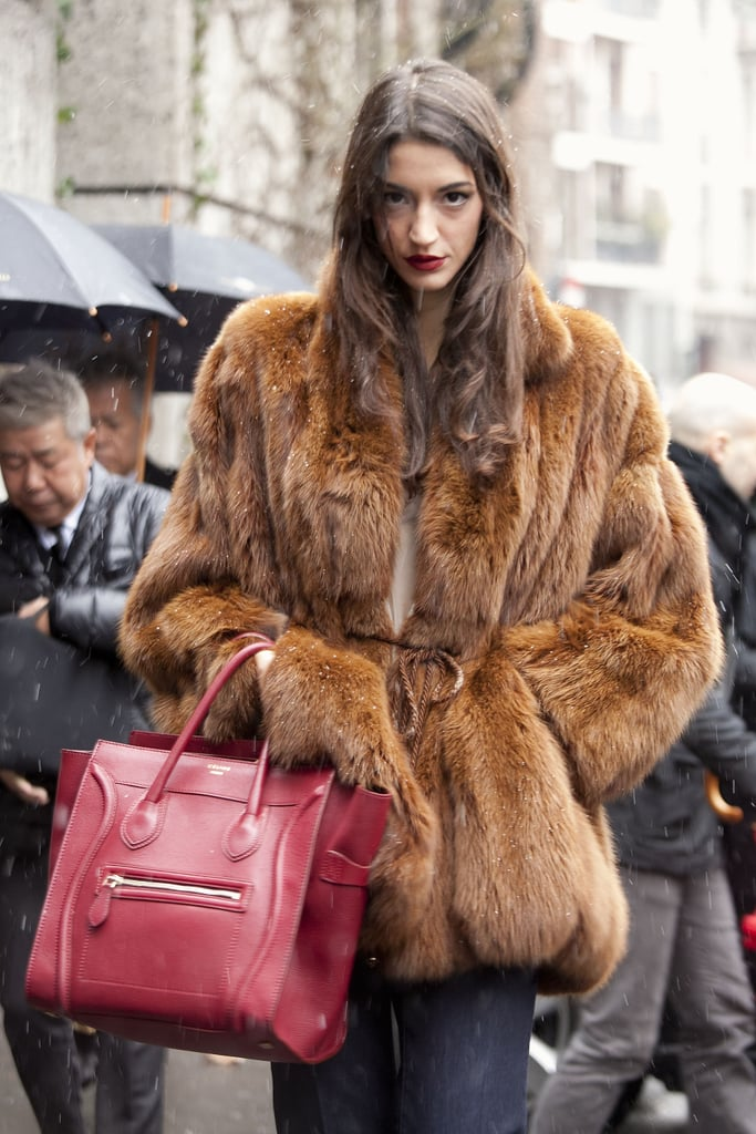 Seriously glamorous street style in a fur, and with a Céline tote in tow.