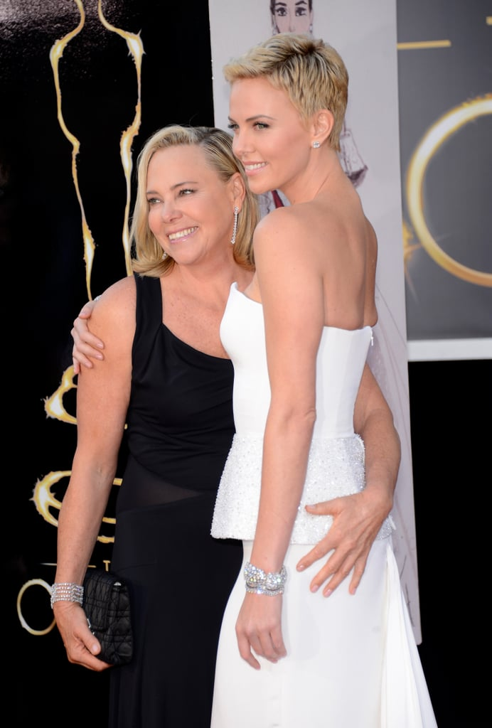 Charlize Theron and her mom Gerda hugged it out for the cameras.
