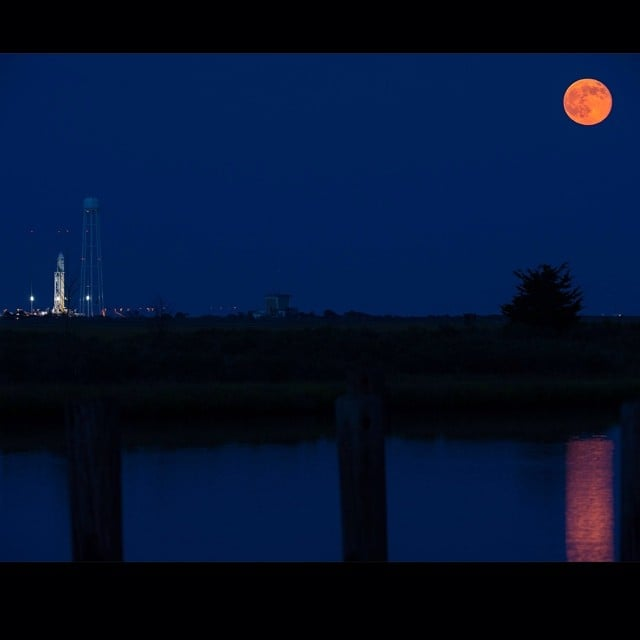 """""""A full moon is seen rising over Orbital Sciences' Antares rocket ready to carry #Orb2 to the #ISS,"""" according to NASA's Instagram on July 12. Source: Instagram user NASA"""