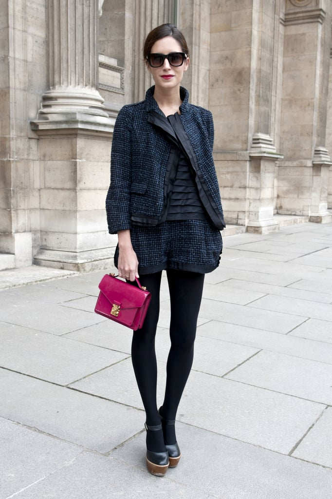 A tweedy shorts suit got a punchy finish with a sweet raspberry bag in hand.
