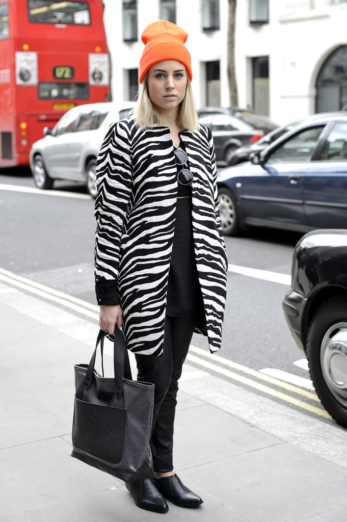 A cool-girl beanie popped against a polished zebra-print coat.