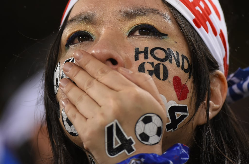 A Japanese fan cried during the game between Japan and Greece.