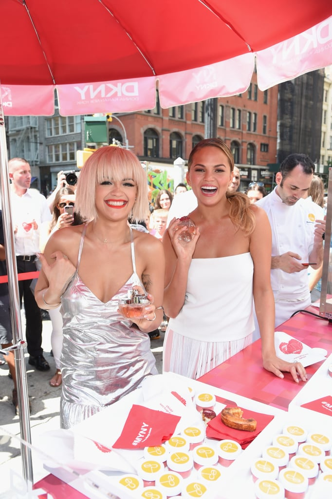 Rita Ora and Chrissy Teigen brought infectious energy to the launch of DKNY's MYNY fragrance launch event in NYC on Tuesday.