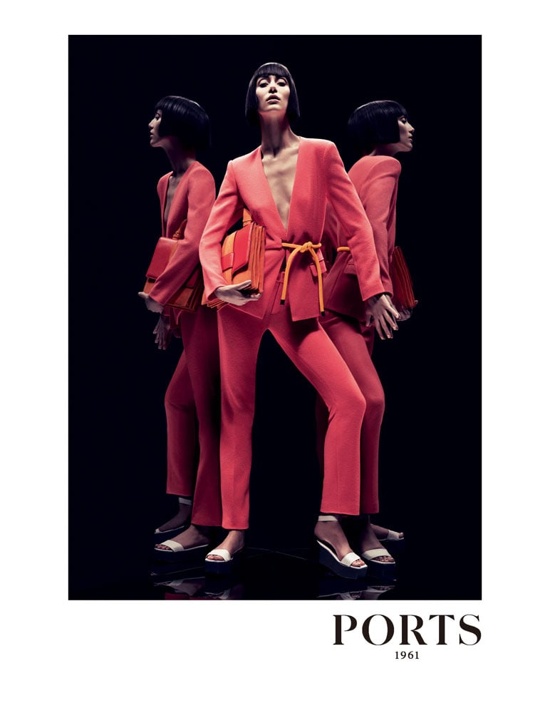Alana Zimmer shows off a bright coral suit from Ports 1961.