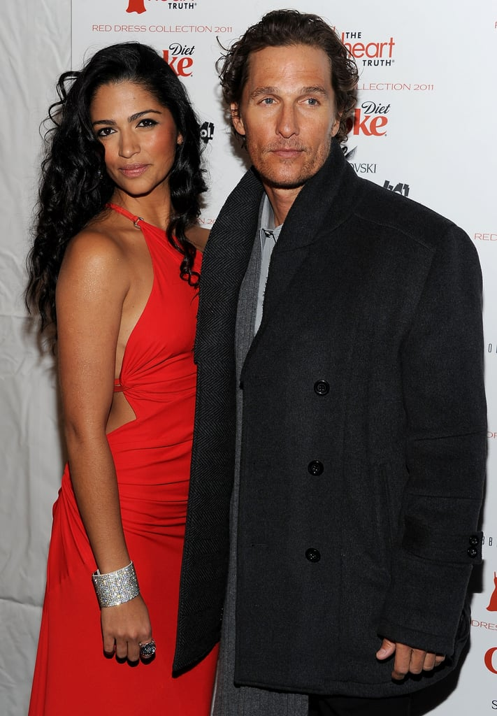 Matthew McConaughey posed with Camila Alves who modeled during the Heart of Truth's show in February 2011.