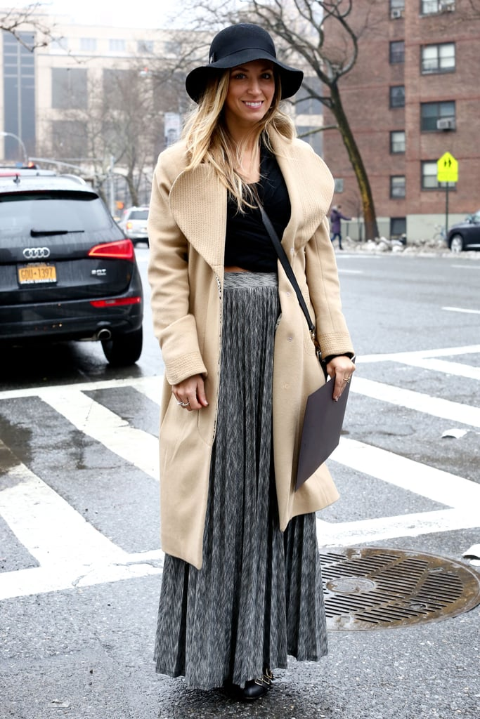 A floppy hat meets a pleated skirt for the full bohemian effect.