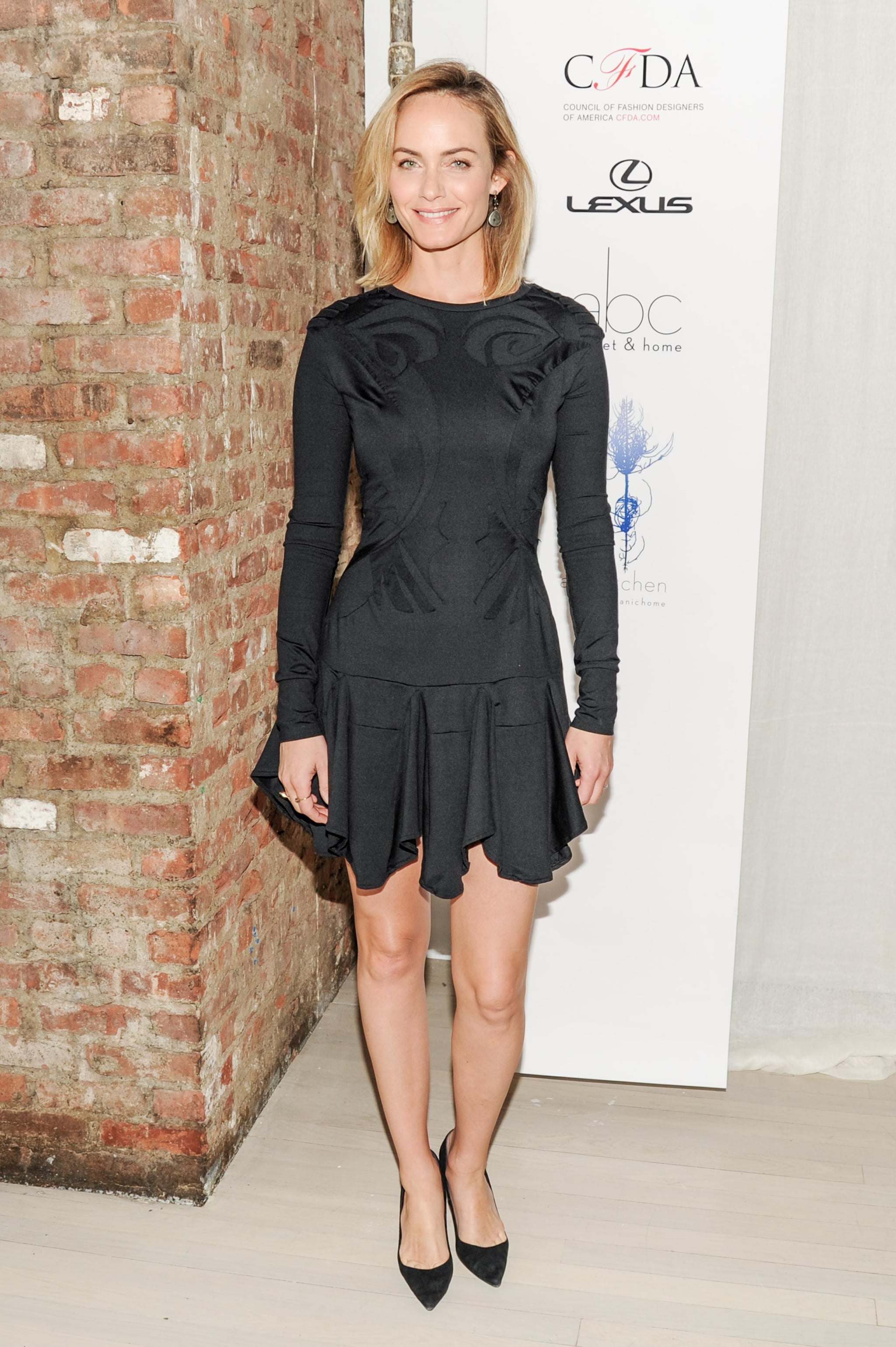 Amber Valletta lunched at the Eco Fashion Challenge event in a long-sleeved black dress.