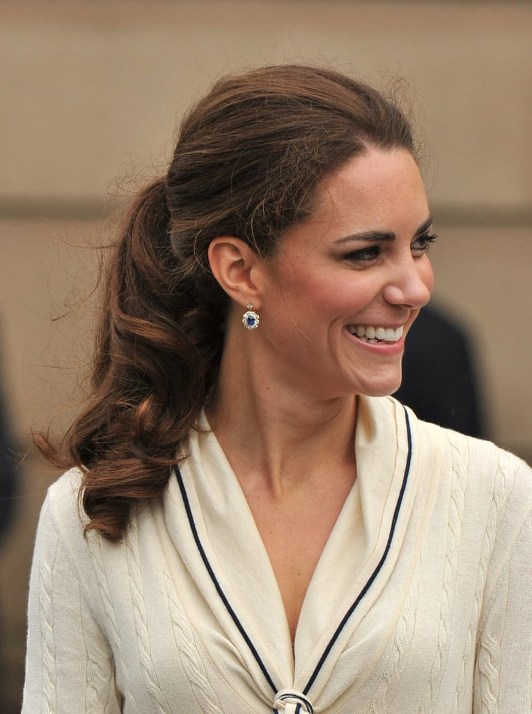 Kate Middleton wore a low ponytail and simple earrings.