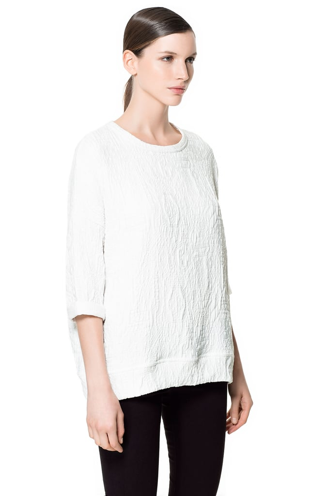 Zara's embossed fabric t-shirt ($60) will be both the casual counter to my pencil skirt at the office and the dressed-up sweatshirt to top my boyfriend jeans on weekends. It's a piece that caters to my somewhat bipolar fashion personality — and that's always a plus. — Hannah Weil