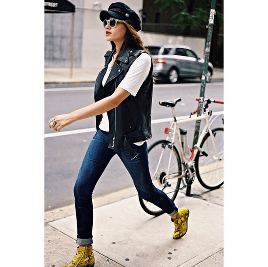 A Breton cap contrasts with the biker appeal of a motorcycle vest and edgy snakeskin booties. Jeans and a white tee are the only neutralizers in this outfit. Source: Instagram user natalieoffduty