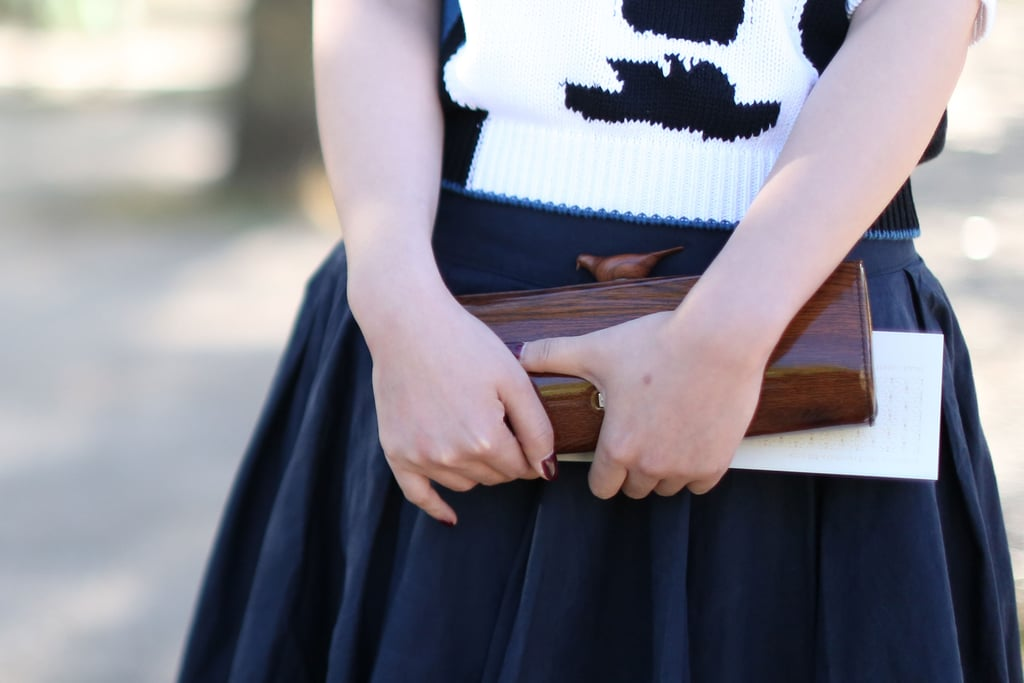 Sometimes, it's not having an It bag that makes your look a standout — like this precious wood box clutch.