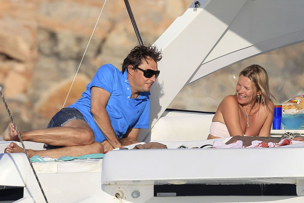 Kate Moss and Jamie Hince shared a laugh on their boat in Spain.