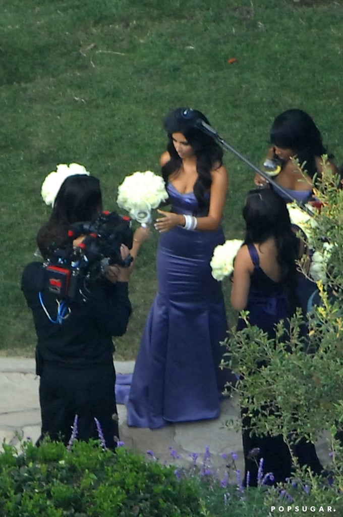 Kim Kardashian wore purple as a bridesmaid for sister Khloé Kardashian's wedding to Lamar Odom at a mansion in Beverly Hills in September 2009.