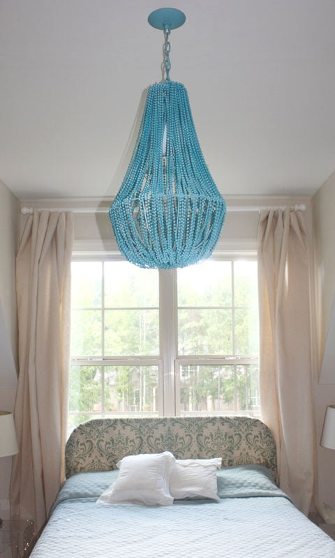 Add a touch of bohemian style with this turquoise beaded chandelier. Source: ROOT design studio