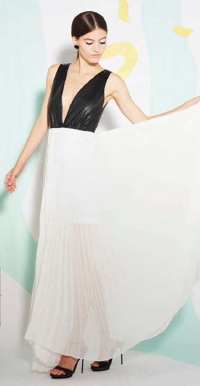 We love a good fashion juxtaposition, and this Alice + Olivia gown provides just that: tough leather on top, delicate accordion pleating on bottom.