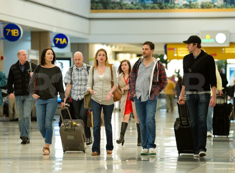 John Krasinski, Emily Blunt, Jimmy Kimmel and Molly McNearney headed out of LAX together.