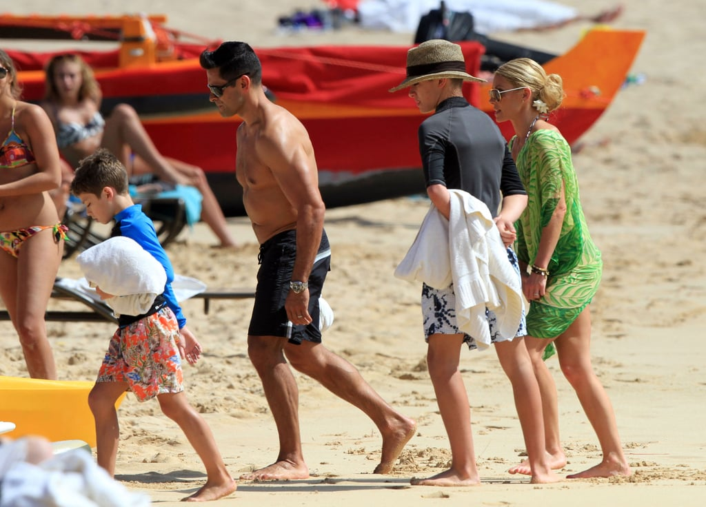 Kelly Ripa hit the beach with her family.