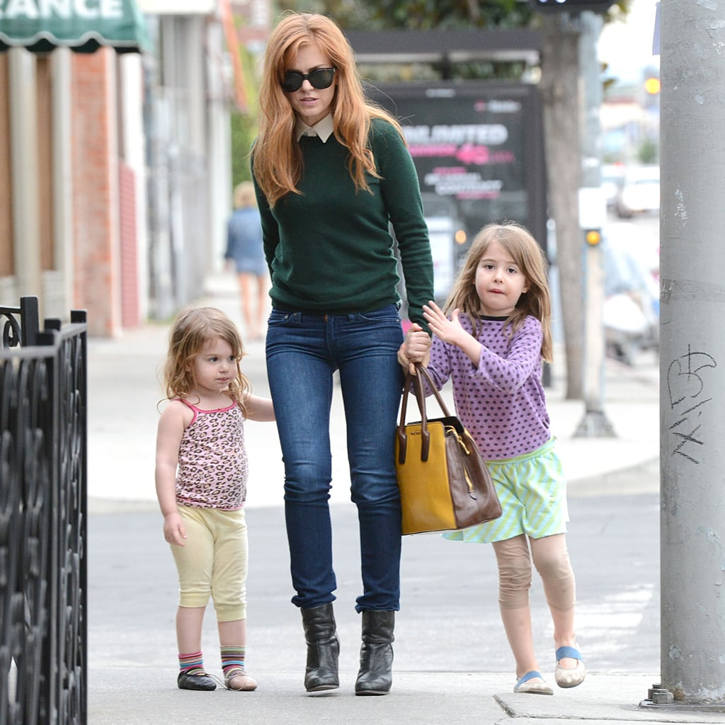 Isla Fisher had her hands full with daughters Elula and Olive after having lunch at Terroni in LA on Jan. 23.