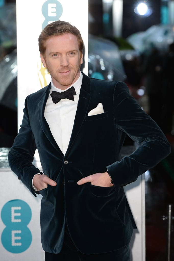 Damian Lewis donned a velvet tuxedo to hit the BAFTA red carpet.