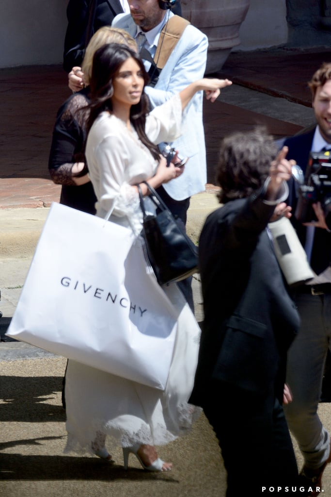 Kim held on to a giant bag from Givenchy.