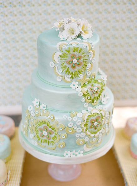 This cake may be blue, but its intricate flower detail makes it unbelievably romantic.  Photo by Lisa Lefkowitz via Style Me Pretty
