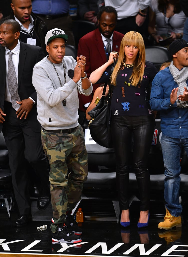 At a New York Knicks game in November 2012, Jay Z showed off camouflage pants while Beyoncé paired Stella McCartney's alphabet top with leather pants and cobalt pumps.