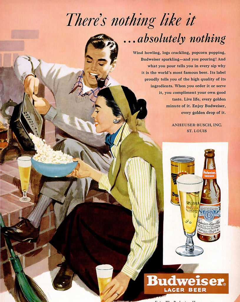"""""""Wind howling, logs crackling, popcorn popping, Budweiser sparkling,"""" reads the copy of this 1950 ad featuring a young couple. Both the man and the woman are casually enjoying a cool glass of Bud on a presumably colder day."""