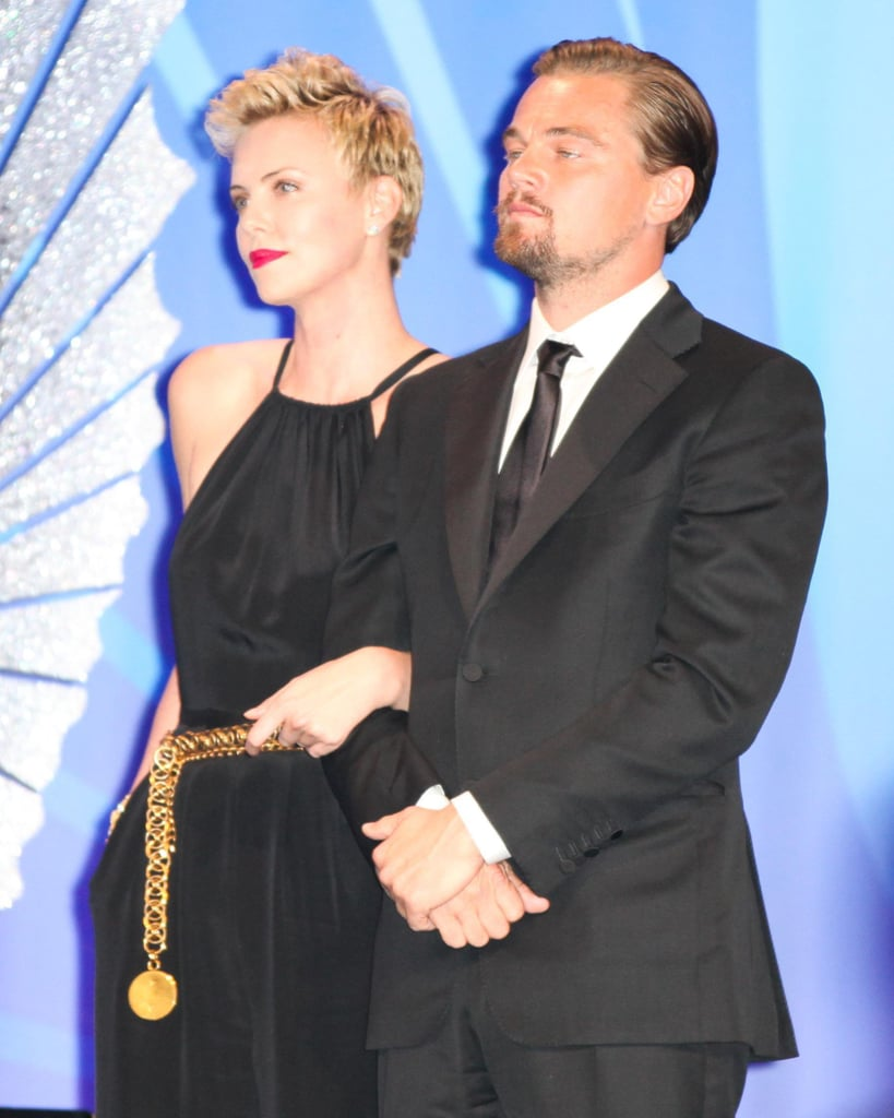 Charlize Theron and Leo linked up to present an award at the GLAAD Media Awards in April 2013.