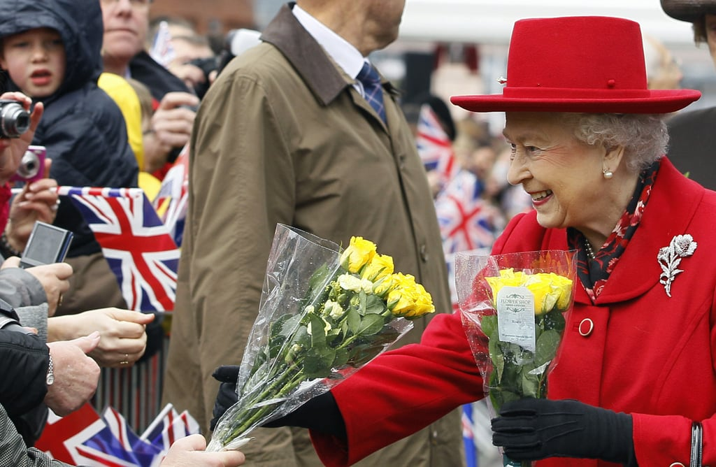 Queen Elizabeth II received flowers from the public.