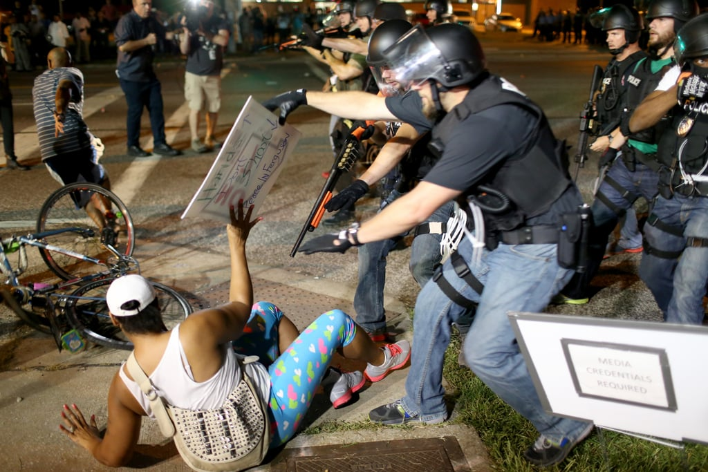 Officers arrested a demonstrator at gunpoint.