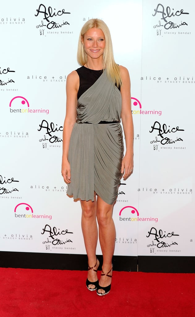 Gwyneth styled an asymmetrical Alexander Wang number with crisscross peep-toe sandals at the Bent on Learning benefit in NYC.